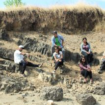 My group sitting atop Sandstone where we found its contact with Igneous Rock